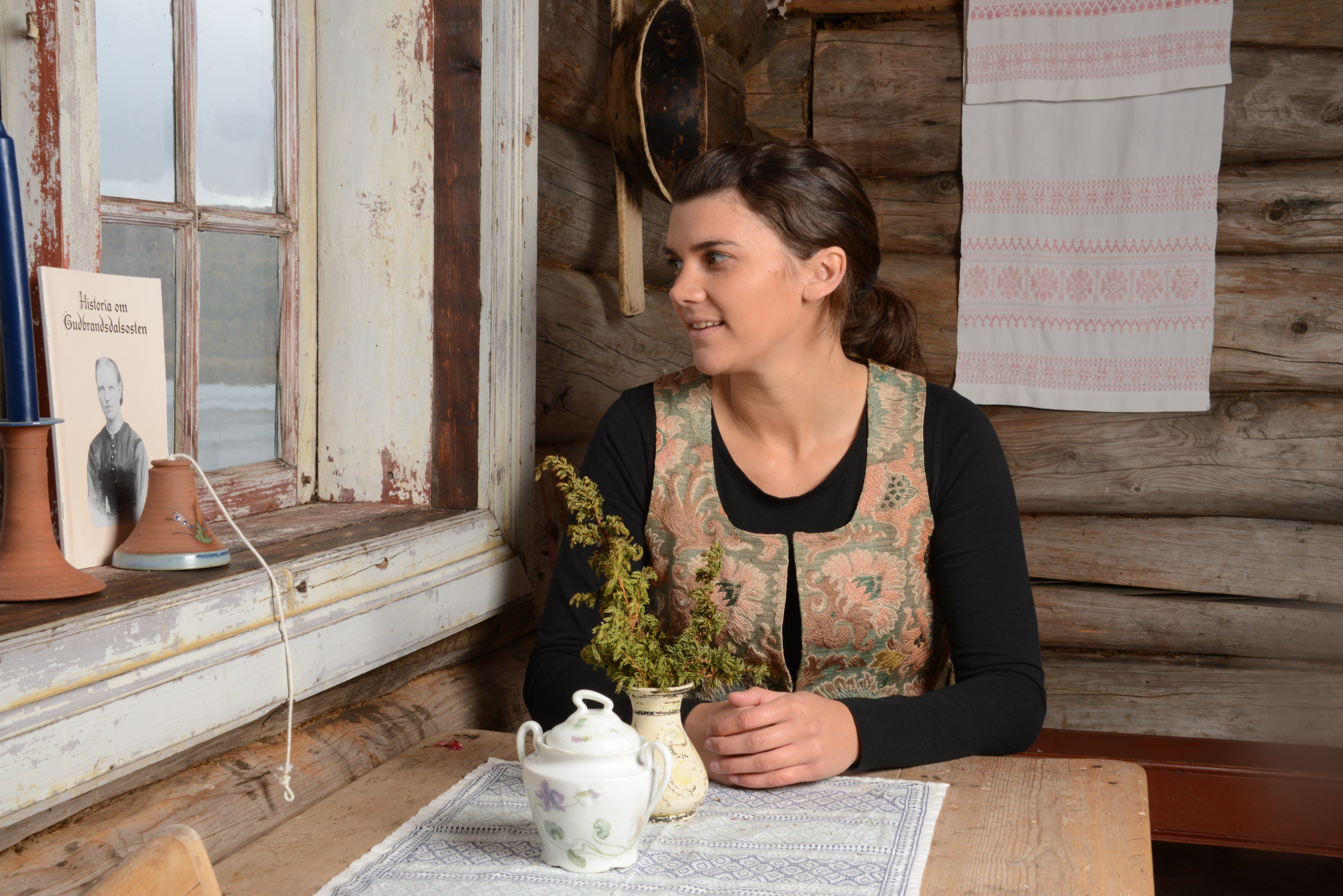 Anne Solbraa in the old wooden house where Anne Hov made the first Brunost.