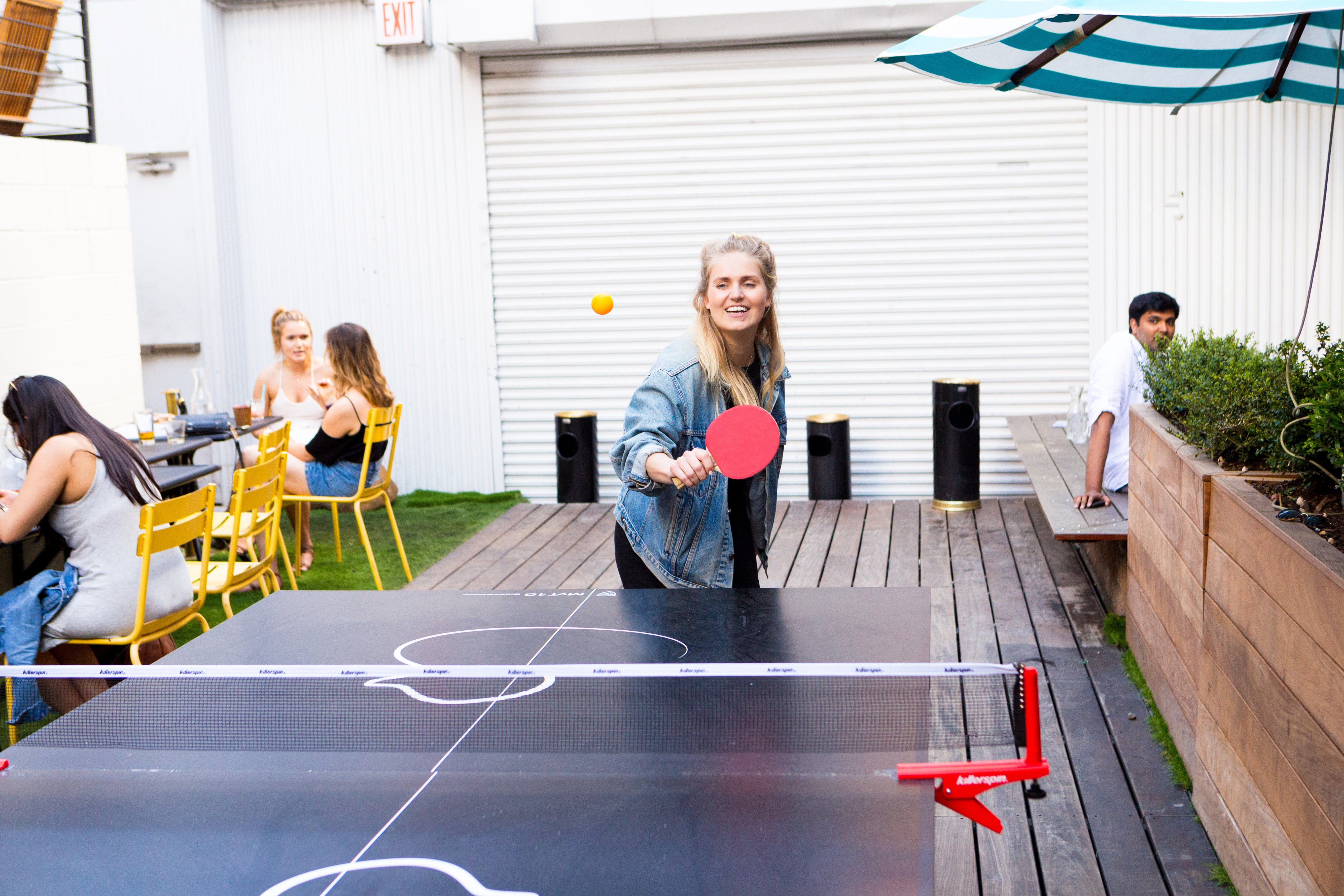 Mette playing table tennis in Brooklyn
